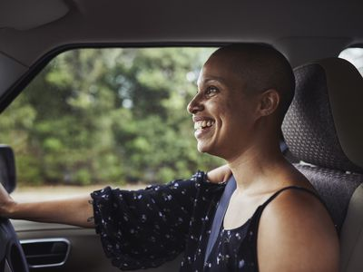 Portrait of laughing woman in car