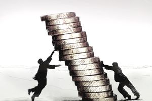 Strong businessman pushing pile of coins over on to struggling businessman