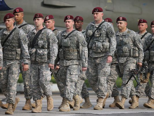 U.S. infantry troops march in formation as they leave an aircraft on their arrival in Poland as part of NATO exercises