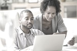 A young couple looks over options for mortgages.