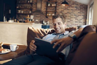 Businessman using a tablet to watch a video