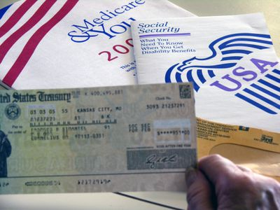 Hand holding a Social Security check