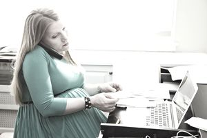 Pregnant woman doing taxes at home