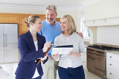 couple smiling at real estate in new home kitchen