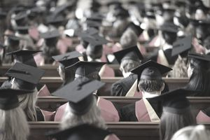 Rear view of students sitting at graduation ceremony