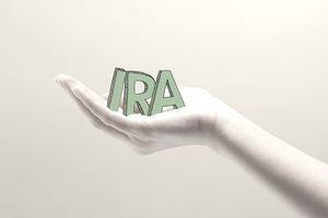 Should I get an IRA? Word IRA held in hand