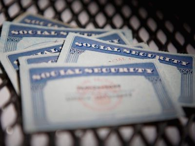 Scattered pile of Social Security cards