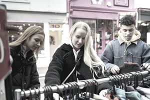 A group of people consider purchasing together to earn a discount