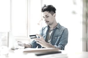 Man with credit card and laptop