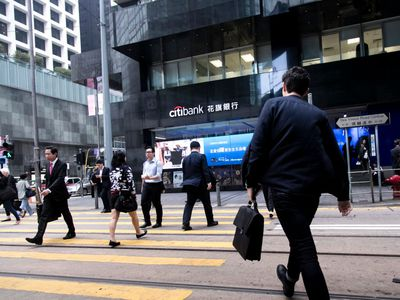 HONG-KONG, CHINA - FEBRUARY 27: Managers go to work in the Central area in the financial center on February 27, 2018 in Hong-Kong, China. Hong-Kong is the third largest financial centre in the world and the Hong-Kong stock exchange is only losing importance to those in London and New York.
