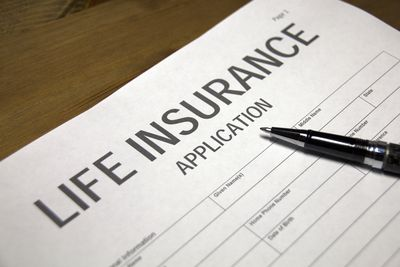 Someone filling out life insurance application