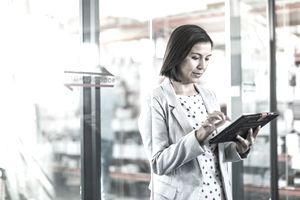 Female businesswoman using tablet computer in a small business