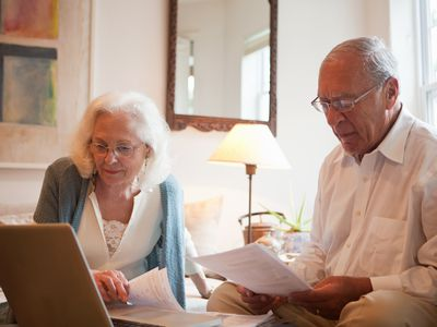 Couple reviewing the beneficiary designation on their IRAs