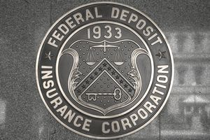 The seal of the Federal Deposit Insurance Corporation (FDIC) on a building wall.