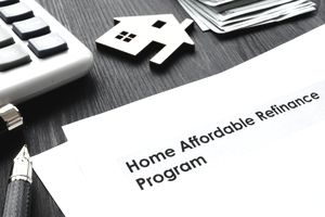 Home Affordable Refinance Program HARP papers on a desk.