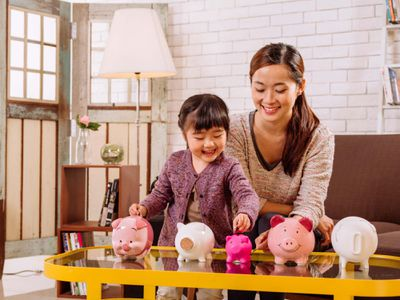 A picture of a mom and child with piggy banks