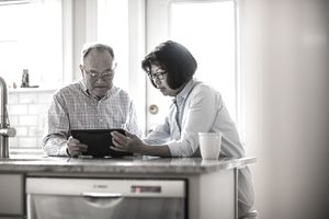 An older couple looking at a tablet