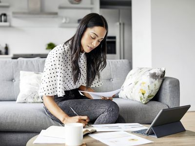 A woman looks over her credit card penalty APR terms.