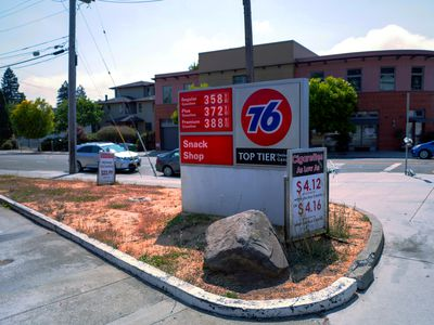Sign shows the prices for gasoline listed at a gas station