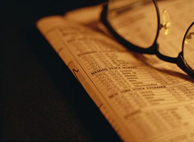 Glasses set on top of a stock report