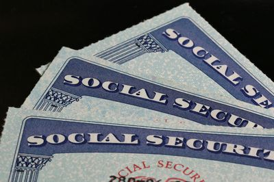 Close-up of the top of three U.S. Social Security cards