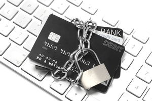 Stack of credit cards wrapped in a chain and padlocked to signify they can not be used for purchases.