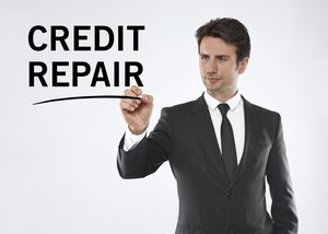 A man writing credit repair on a clear screen
