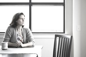 A woman contemplating low interest loans to help with her finances