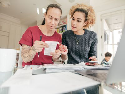 two women on computer paying bills