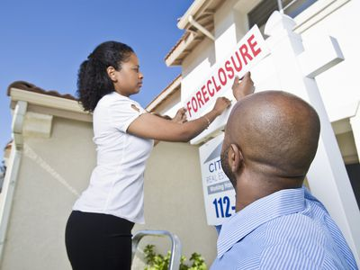 Homeowner getting a foreclosure sign on home