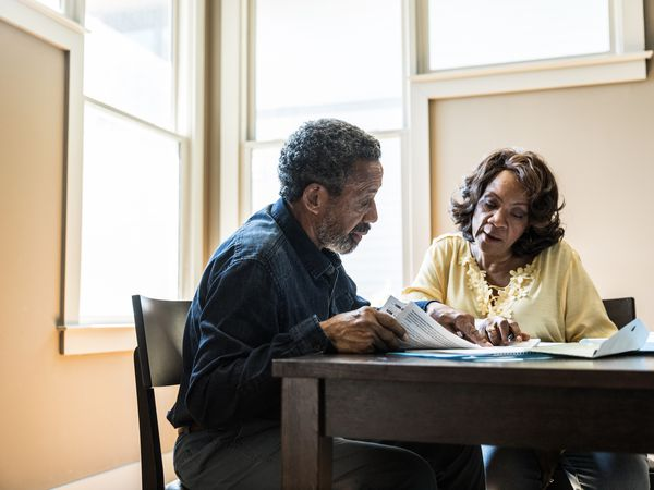 Senior couple reviewing financial documents at home