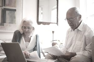 Senior couple reviewing the beneficiary designation on their IRAs