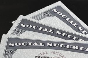 Close up of Social Security cards laying in a pile.