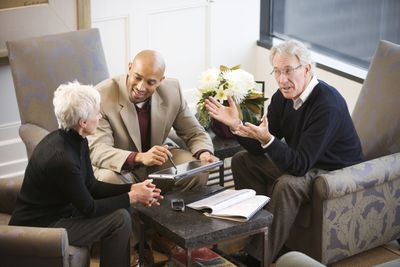 Financial adviser meeting with clients