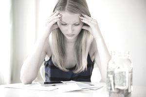 Woman looking stressed about money