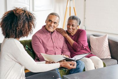 An elderly couple working on their will with a legal advisor.