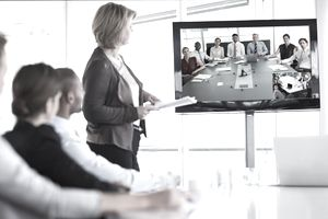 Businesswoman giving presentation in conference room and for virtual meeting