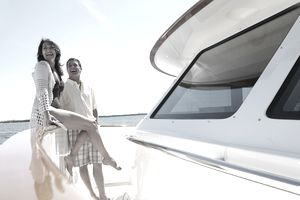 Couple smiling on deck of luxury yacht