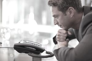Man waiting for the phone to ring.