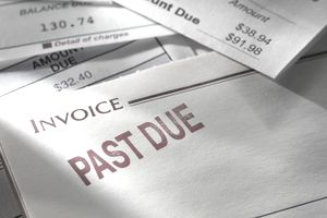 Past Due invoice on stack of bills