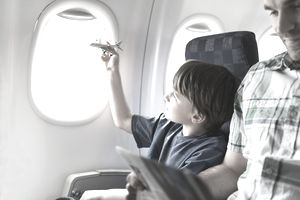 young boy on a plane with father