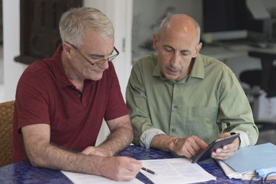 Couple reviewing paperwork together