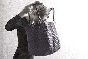 Woman looking into a large purse