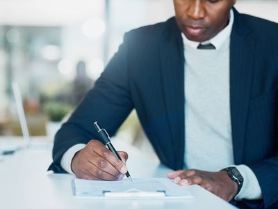 Male creditor filling out proof of claim form