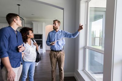 Male real estate agent shows new home