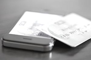 A credit card propped on a cellphone