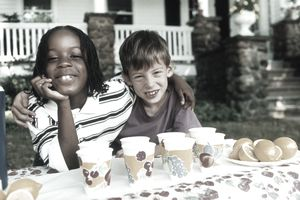 TWO BOYS AT LEMONADE STAND, AFRICAN AMERICAN AND WHITE