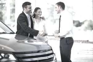 Couple Finalizing a New Car Purchase