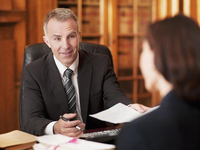 A woman meeting with a businessman in his office