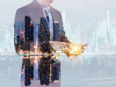 Forex broker checking his smart phone with double exposure of abstract business chart bars on bright city background